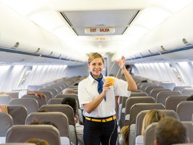Flight attendant making an in-flight safety demonstration