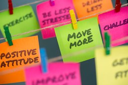 Colorful Post-It notes featuring positive weight-loss tips