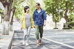 Couple walking down the street for exercise