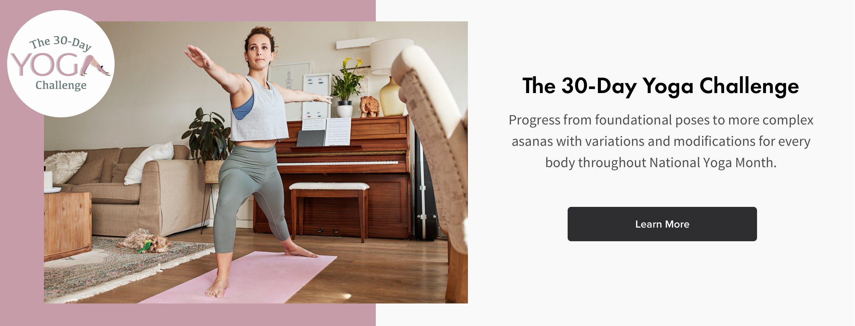 woman doing yoga in living room on pink yoga mat on wood floor
