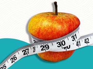 A tape measure wrapped around an apple on a colorful background
