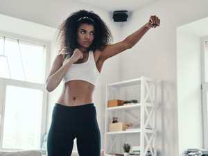 woman doing a boxing workout at home without equipment