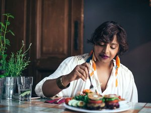 A woman eating a healthy meal at home