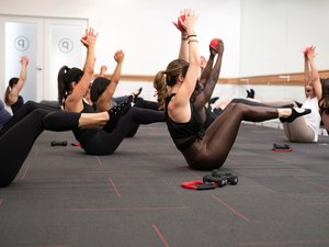 People taking a Pure Barre workout class