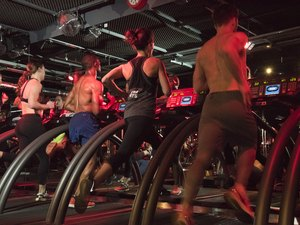 People running on treadmills during a Barry's Bootcamp workout class