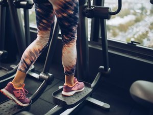 woman on an elliptical machine wearing colorful leggings