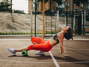 Woman using a foam roller for post-marathon recovery