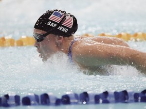 Olympic gold medalist Kaitlin Sandeno swimming in pool
