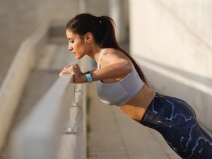 Woman doing wall push-ups