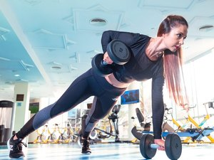 Woman lifting heavy weights