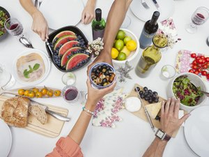 Hands reaching for plant based diet foods