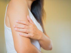Closeup female's arm. Arm pain and injury. Health care and medical concept.