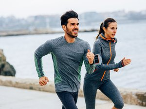 Friends jogging by the sea