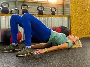 woman demonstrating a basic bridge exercise