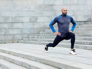 Man doing lunge exercise outdoors to build lower-body strength