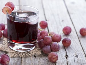 A glass of icy red grape juice