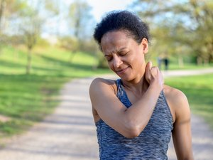 Woman with a pinched nerve in her neck