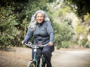 Senior Mexican Woman Riding Bicycle