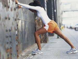Woman Warming Up With Shin Splint Stretches and Exercises