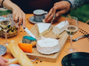 Friends dining on saturated fat in cheese