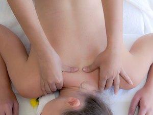 Woman gets back massage spa by massage therapist.
