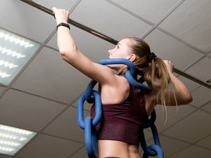 young woman with horizontal bar and weight chain