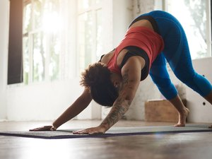 Woman with curly hair doing yoga