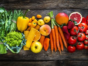 Healthy fresh rainbow colored fruits and vegetables in a row