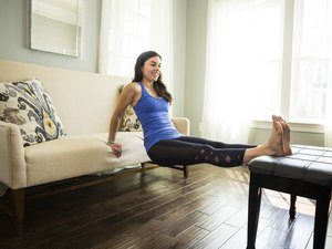 Woman doing triceps dips during her at-home upper-body workout