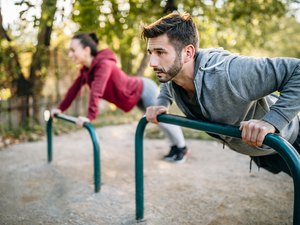 Couple working out together in the park