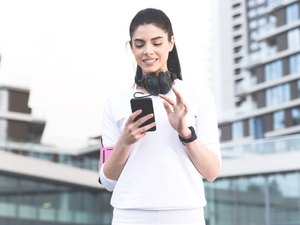 Woman using walking app to track walking workout