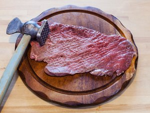 meat tenderizer and beaten slice of veal