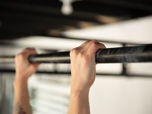 Hands on pull-up bar for at-home strength training workout