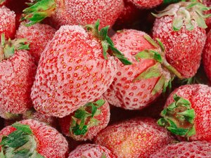 Frozen strawberries with frost on them