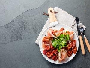Plate of iberian spanish antipasto - ham serrano and salami