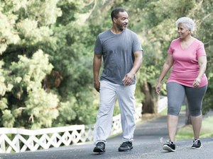 Couple Walking for Exercise Around Their Neighborhood