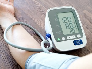 Human check blood pressure monitor and heart rate monitor with digital pressure gauge. Health care and  Medical concept