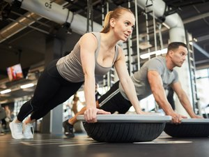 Couple Doing Balance Exercises in Gym