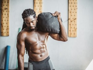 Man exercising with a sandbag
