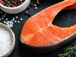 Raw salmon steak and spices