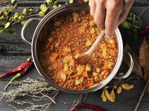 How to thicken stew in slow cooker man preparing a vegetarian lentil stew