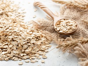 Rolled oats, ears of wheat and wooden spoon