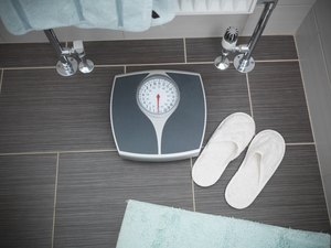 Scales and slippers in senior person's bathroom