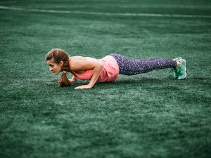 woman doing burpees for at-home crossfit amrap workout