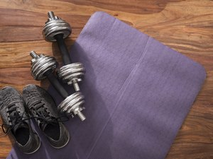 weights on an exercise mat for dumbbell exercises