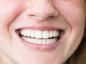 Woman with beautiful toothy smile