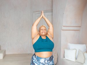 Older Black woman doing yoga pose for anxiety