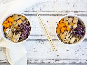 Miso Ramen soup with noodles, hokaido pumpkin, red radish sprouts, fried tofu, shimeji mushroom and king trumpet mushroom