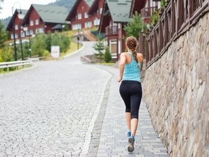 Young athletic woman jogging in mountain resort
