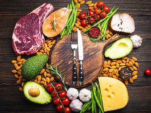 Top view of a selection of foods that are good sources of dietary fat